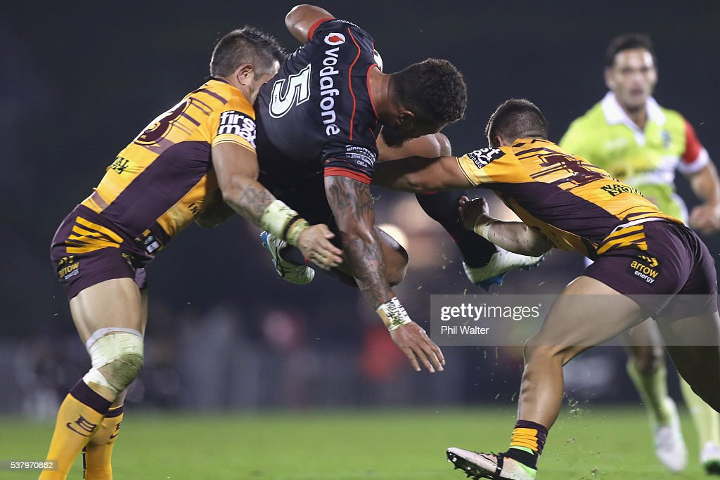 Manu Vatuvei of the Warriors is tackled by Corey Parker (L) and Kodi Nikorima (R) of the Broncos during the round 13 NRL match between the New Zealand Warriors and the Brisbane Broncos at Mt Smart Stadium on June 4, 2016 in Auckland, New Zealand.