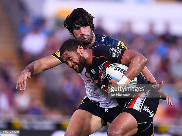 Manu Vatuvei of the Warriors is tackled by James Tamou of the Cowboys during the round seven NRL match between the North Queensland Cowboys and the...