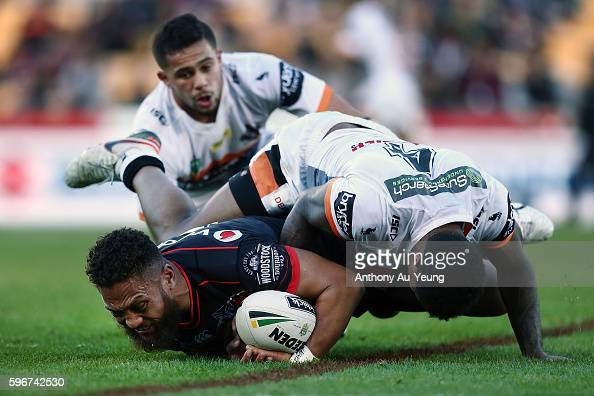 Manu Vatuvei of the Warriors is tackled by Kevin Naiqama of the Tigers during the round 25 NRL match between the New Zealand Warriors and the Wests...