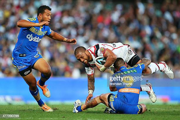 Manu Vatuvei of the Warriors is tackled by Nathan Peats of the Eels during the round one NRL match between the Parramatta Eels and the New Zealand...
