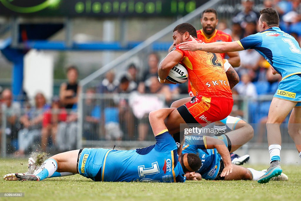 Manu Vatuvei of the Warriors is tackled during the NRL Trial Match between the New Zealand Warriors and the Gold Coast Titans at Toll Stadium on February 13, 2016 in Whangarei, New Zealand.