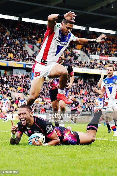 Manu Vatuvei of the Warriors scores a try against Dane Gagai of the Knights during the round 12 NRL match between the New Zealand Warriors and the...