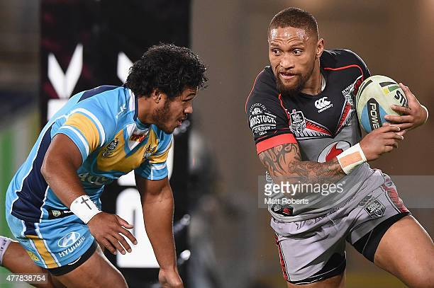 Manu Vatuvei of the Warriors takes on the defence during the round 15 NRL match between the Gold Coast Titans and the New Zealand Warriors at Cbus...