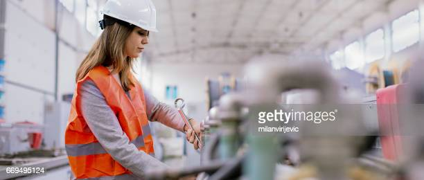Manual female worker in the factory