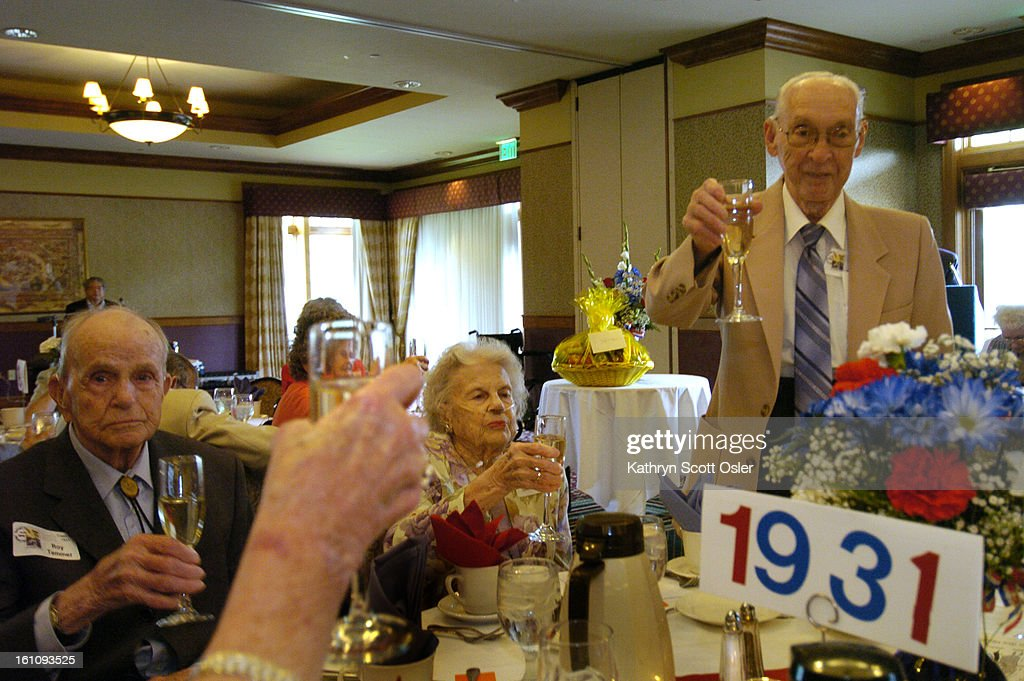 DENVER, CO, AUG. 26, 2006- Manual Training High School Reunion for classes 1930-1939 at the Pinehurst Country Club. Herbert Schoenfeld<cq> toasts his classmates of 1931, celebrating their 75th class reunion. Next to Schoenfeld is his wife Mildred<cq> and Roy Temmer,<cq> left.