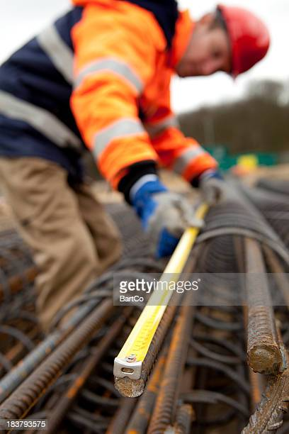 Manual worker busy with road construction. Building a bridge.