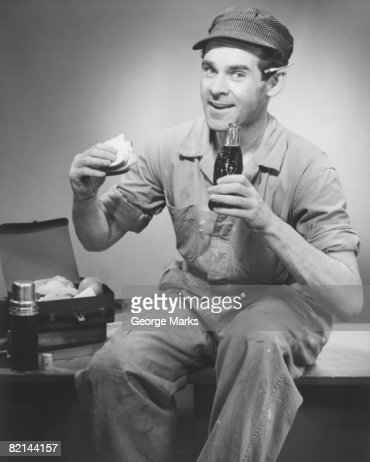 Manual worker having lunch break, (B&W), portrait : Stock Photo