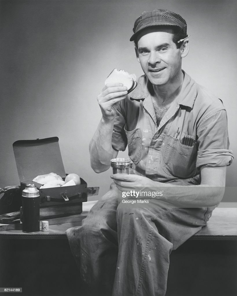 Manual worker having lunch break, (B&W), portrait : Stock Photo