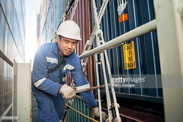 Manual worker on container ship