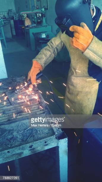 Manual Worker Welding In Industry