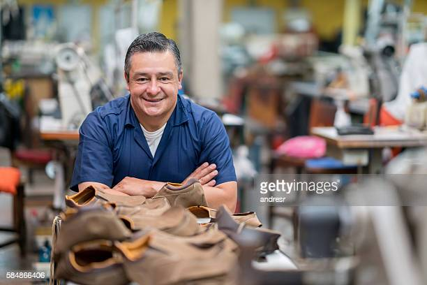 Manual worker working at a shoe-making factory