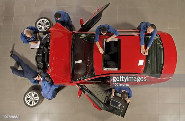 manual workers reparing the car