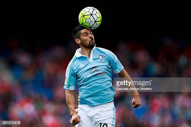Manuel Agudo Duran alias Nolito of RC Celta de Vigo saves on a header during the La Liga match between Club Atletico de Madrid and Real Club Celta de...