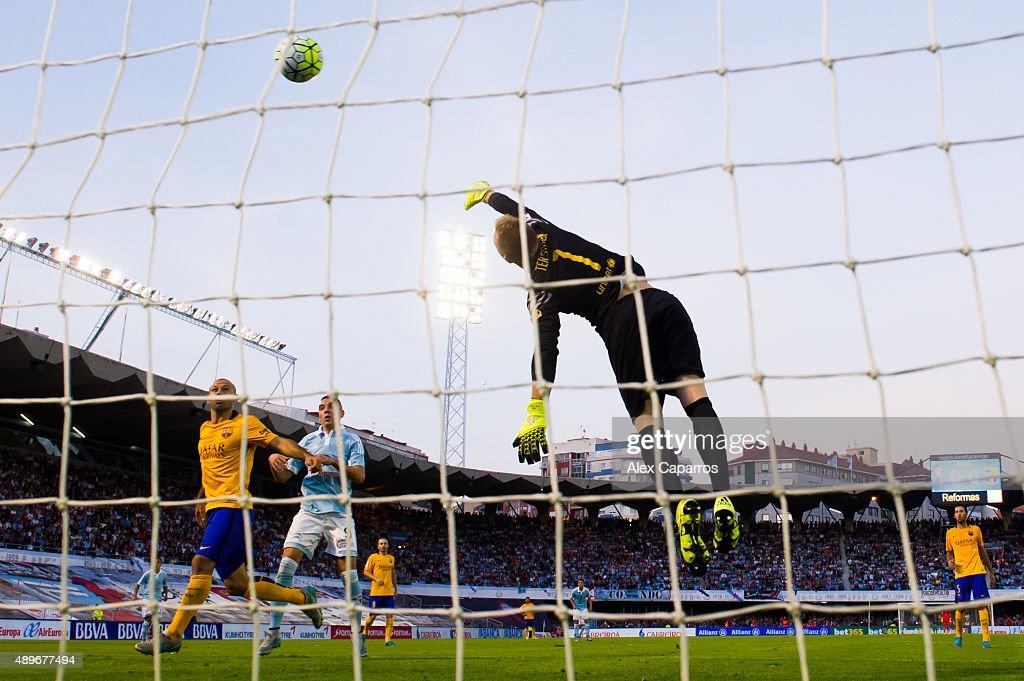 Manuel Agudo 'Nolito' of Celta Vigo heads the ball past goalkeeper MarcAndre Ter Stegen of FC Barcelona and scores the opening goal during the La...