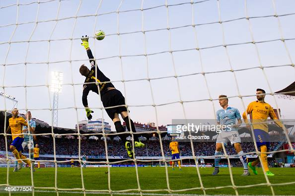 Manuel Agudo 'Nolito' of Celta Vigo heads the ball past goalkeeper MarcAndre Ter Stegen of FC Barcelona and scores the opening goal during the La...