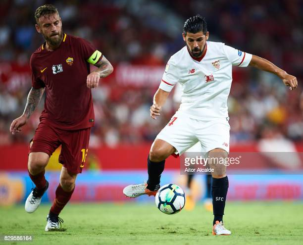 Manuel Agudo 'Nolito' of Sevilla FC being followed by Daniele De Rossi of AS Roma during a Pre Season Friendly match between Sevilla FC and AS Roma...