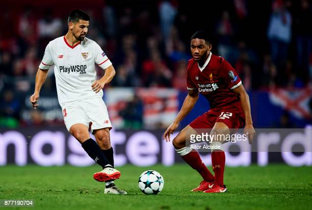 Manuel Agudo 'Nolito' of Sevilla FC duels for the ball with Joe Gomez of Liverpool FC during the UEFA Champions League group E match between Sevilla...