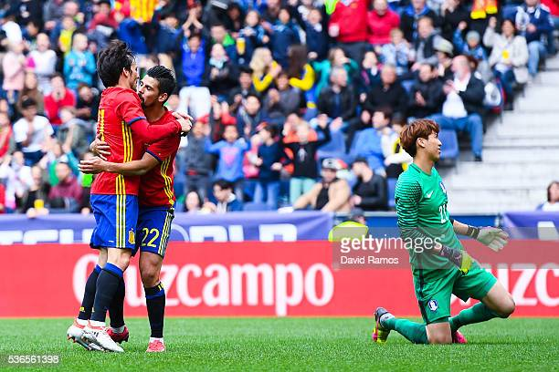 Manuel Agudo 'Nolito' of Spain celebrates with his teammante David Silva after scoring his team's third goal during an international friendly match...