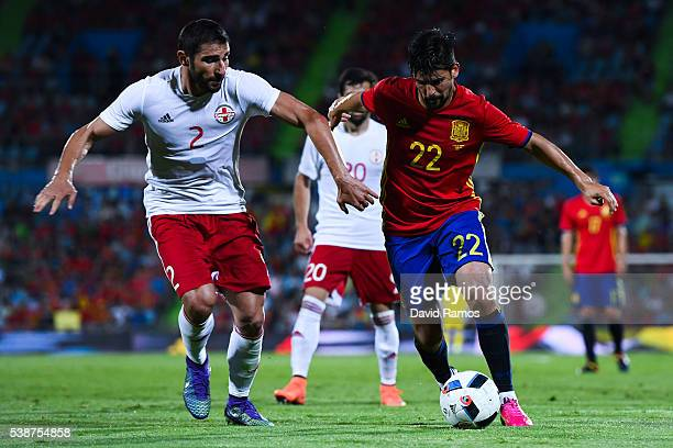 Manuel Agudo 'Nolito' of Spain competes for the ball with Lobzhanidze of Georgia during an international friendly match between Spain and Georgia at...