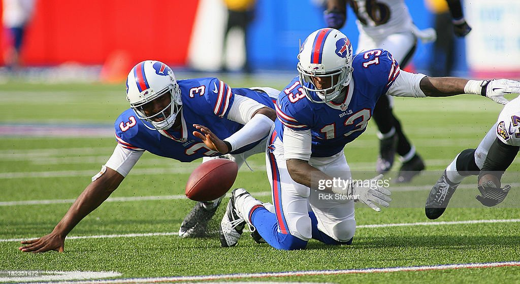 EJ Manuel #3 and Steve Johnson #13 of the Buffalo Bills try to get control of Manuel's fumble in the fourth quarter against the Baltimore Ravens at Ralph Wilson Stadium on September 29, 2013 in Orchard Park, New York.Buffalo won 23-20.