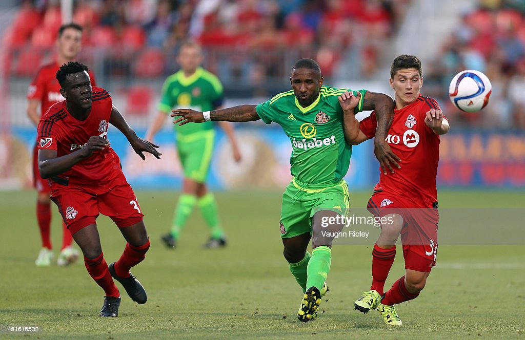 Manuel Aparicio #34 of Toronto FC and Jermain Defoe #18 of Sunderland AFC battle for the ball during a friendly match at BMO Field on July 22, 2015 in Toronto, Ontario, Canada.
