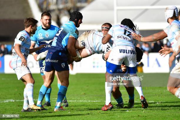 Manuel Carizza of Racing 92 is tackled by Alexandre Dumoulin of Montpellier during the Top 14 match between Racing 92 and Montpellier on November 26...
