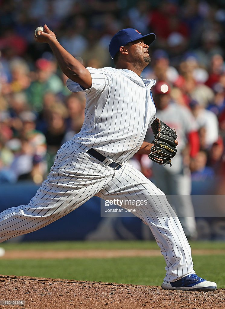 Manuel Corpas #60 of the Chicago Cubs pitches in the 7th inning, giving up six singles and 5 runs to the Cincinnati Reds at Wrigley Field on September 20, 2012 in Chicago, Illinois.