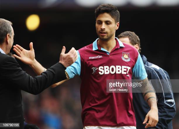 Manuel da Costa of West Ham United celebrates with his manager Avram Grant after scoring during the Barclays Premier League match between West Ham...