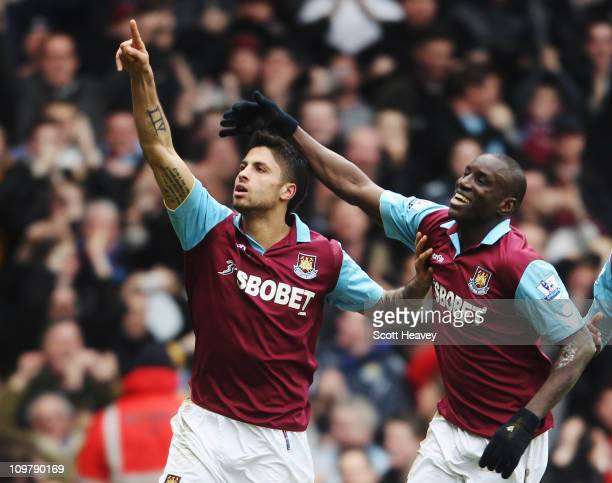 Manuel da Costa of West Ham United celebrates with team mate Demba Ba after scoring during the Barclays Premier League match between West Ham United...