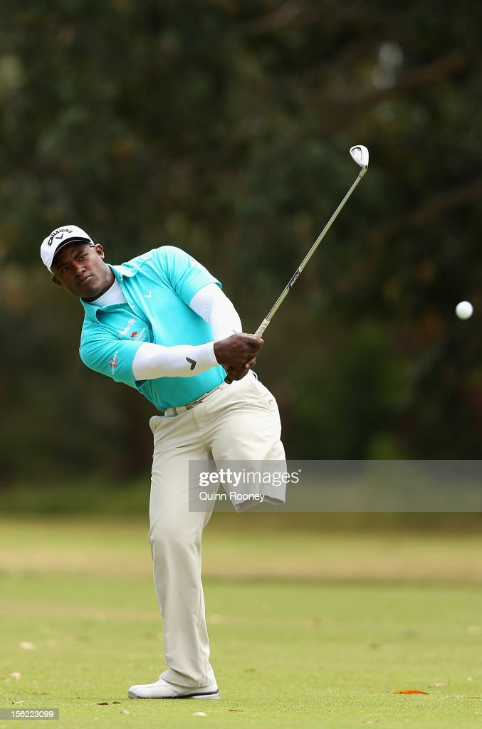 Manuel De Los Santos of the Dominican Republic plays an approach shot during the Melbourne Golf Invitational Pro-Am at Woodlands Golf Club on November 12, 2012 in Melbourne, Australia.