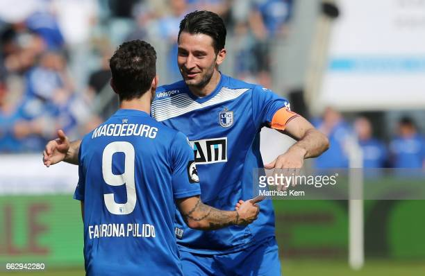 Manuel Farrona Pulido of Magdeburg celebrates with team mate Marius Sowislo after scoring his teams first goal during the third league match between...