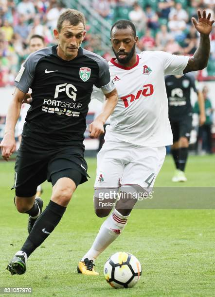 Manuel Fernandes of FC Lokomotiv Moscow vies for the ball with Rustem Mukhametshin of FC Tosno Khabarovsk during the Russian Premier League match...