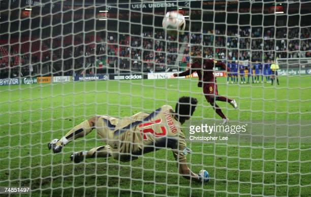 Manuel Fernandes of Portugal has his penalty saved by Emiliano Viviano of Italy during the UEFA U21 Championship Olympic playoff match between...