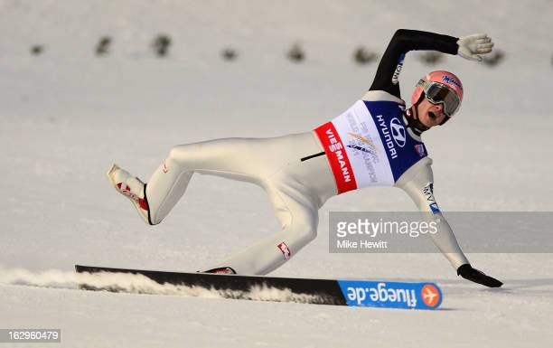 Manuel Fettner of Austria loses a ski during the Men's Ski Jumping Team HS134 Final Round at the FIS Nordic World Ski Championships on March 2 2013...
