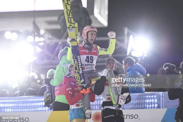 Manuel Fettner Stefan Kraft and Gregor Schlierenzauer of Austria celebrate after Kraft won his first competition jump of the men normal hill...