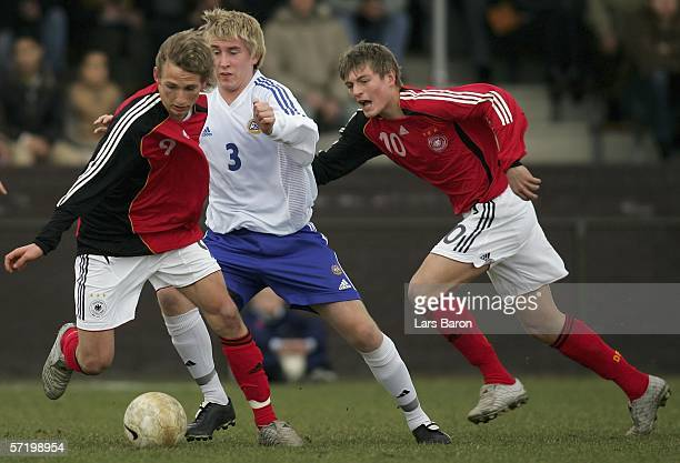 Manuel Fischer and Toni Kroos of Germany in action against Kalle Maekinen of Finland during the Men's Under 17 European Championship qualifier match...