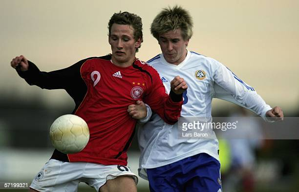 Manuel Fischer of Germany in action with Kalle Maekkinen of Finland during the Men's Under 17 European Championship qualifier match between Germany...