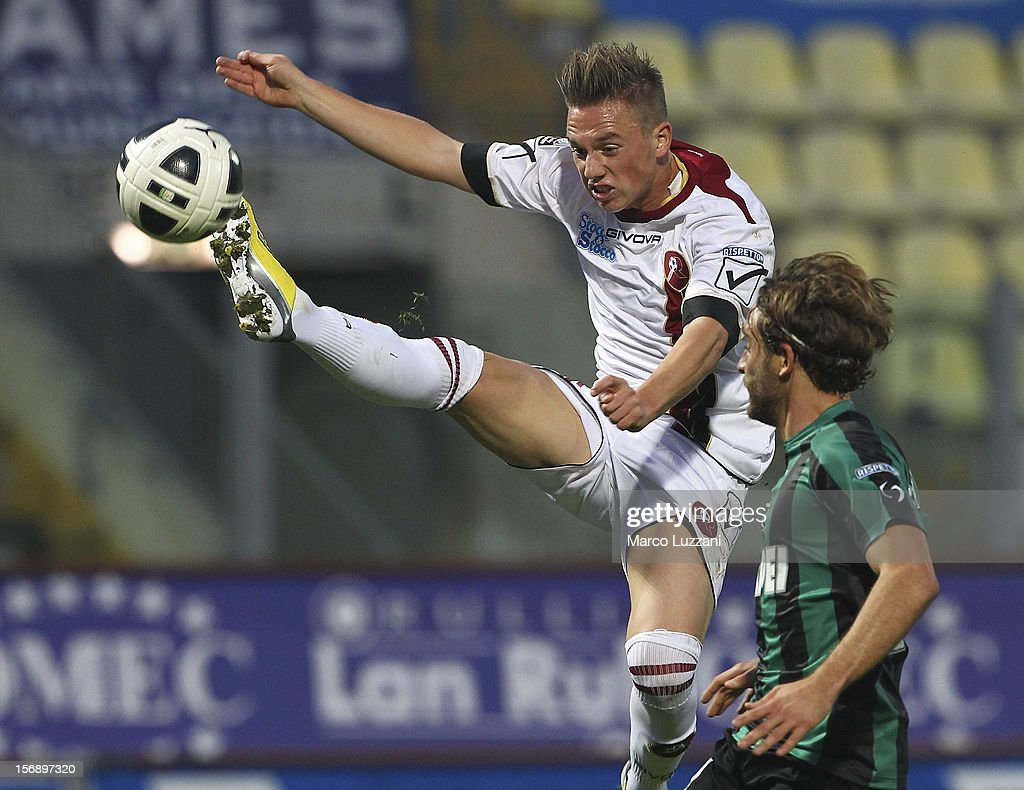 Manuel Fischnaller of Reggina Calcio competes for the ball with Lorenzo Laverone of US Sassuolo during the Serie B match between US Sassuolo and Reggina Calcio at Alberto Braglia Stadium on November 24, 2012 in Modena, Italy.