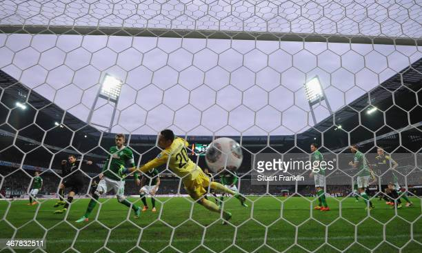 Manuel Friedrich of Dortmund scores his goal during the Bundesliga match between Werder Bremen and Borussia Dortmund at Weserstadion on February 8...