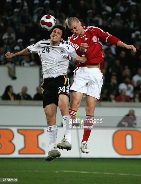 Manuel Friedrich of Germany and Nicklas Bendtner of Denmark go up for a header during the international friendly match between Germany and Denmark at...