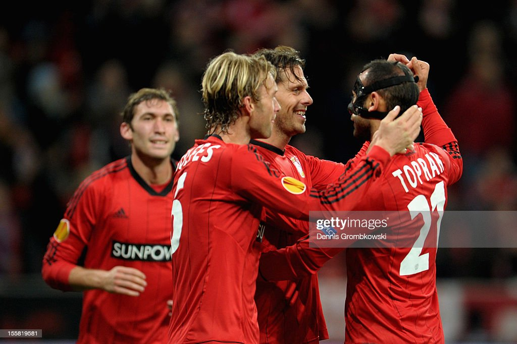 <a gi-track='captionPersonalityLinkClicked' href=/galleries/search?phrase=Manuel+Friedrich&family=editorial&specificpeople=671679 ng-click='$event.stopPropagation()'>Manuel Friedrich</a> of Leverkusen celebrates with teammates <a gi-track='captionPersonalityLinkClicked' href=/galleries/search?phrase=Oemer+Toprak&family=editorial&specificpeople=5395932 ng-click='$event.stopPropagation()'>Oemer Toprak</a> and <a gi-track='captionPersonalityLinkClicked' href=/galleries/search?phrase=Simon+Rolfes&family=editorial&specificpeople=635100 ng-click='$event.stopPropagation()'>Simon Rolfes</a> after scoring his team's third goal during the UEFA Europa League Group K match between Bayer 04 Leverkusen and SK Rapid Wien at BayArena on November 8, 2012 in Leverkusen, Germany.