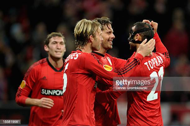 LEVERKUSEN GERMANY NOVEMBER Manuel Friedrich of Leverkusen celebrates with teammates Oemer Toprak and Simon Rolfes after scoring his team's third...