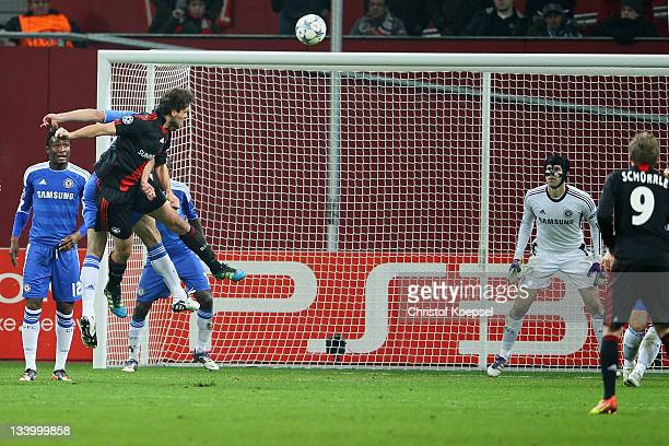Manuel Friedrich of Leverkusen scores the second goal against Peter Cech of Chelsea during the UEFA Champions League group E match between Bayer 04...