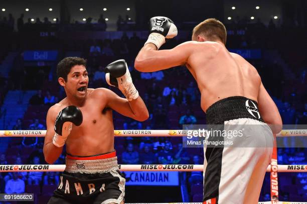 Manuel Garcia reacts as he defends himself against Dario Bredicean during the super middleweight match at the Bell Centre on June 3 2017 in Montreal...