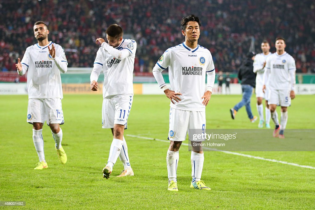 Manuel Gulde Dimitrij Nazarov and Hiroki Yamada of Karlsruhe react after the DFB Cup match between Kickers Offenbach and Karlsruher SC at...
