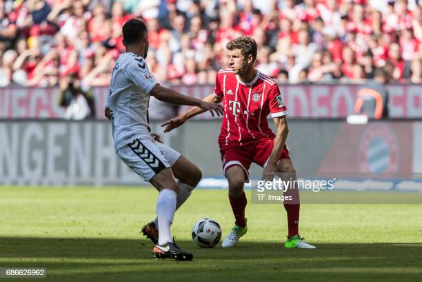 Manuel Gulde of Freiburg and Pascal Stenzel of Freiburg controls the ball during the Bundesliga match between Bayern Muenchen and SC Freiburg at...