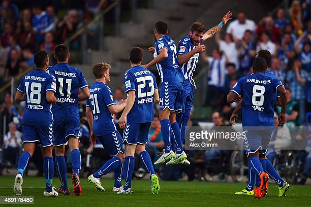 Manuel Gulde of Karlsruhe celebrates his team's third goal with team mates during the Second Bundesliga match between Karlsruher SC and FC St Pauli...