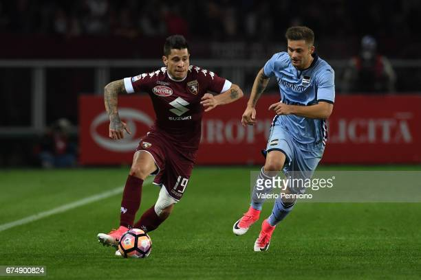 Manuel Iturbe of FC Torino in action against Karol Linetty of UC Sampdoria during the Serie A match between FC Torino and UC Sampdoria at Stadio...