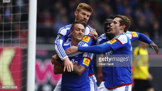Manuel Janzer of Kiel celebrates with teammates after his team's second goal during the 3 liga match between Holstein Kiel and Fortuna Koeln at...