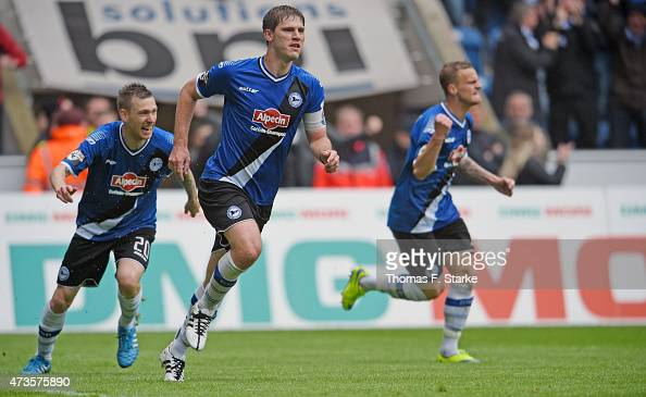 Manuel Junglas Fabian Klos and Christoph Hemlein of Bielefeld celebrate their teams first goal during the Third League match between Arminia...